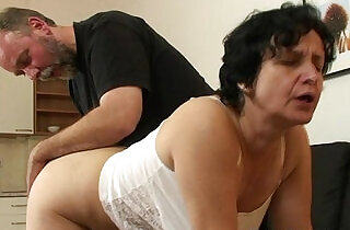 Granny in white lingerie swallowing two cocks after pussy toying