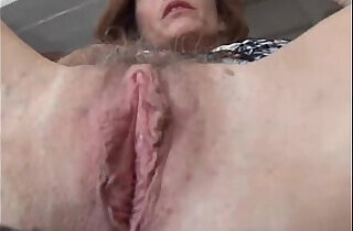 Mature redhead fucks her pussy and asshole
