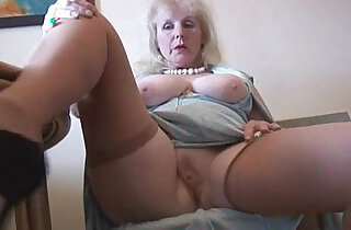 Curvy mature british milf lady in stockings strips and poses