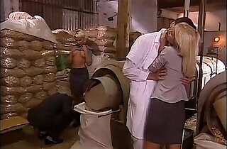 Sexual orgy in a factory with blonde sluts