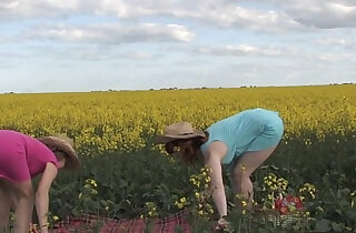 Natural lesbian teen girls on a canola field